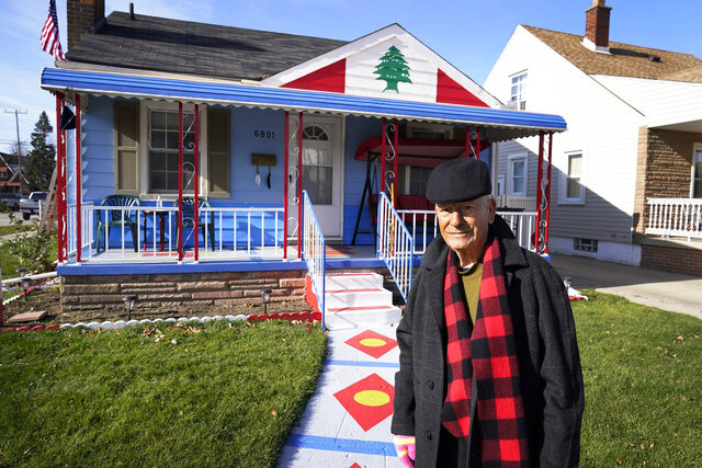 Samih Zreik stands in front of his house, Thursday, Nov. 19, 2020, in Dearborn, Mich. Zreik painted his house in tribute to Lebanon following the blast at Beirut's port that killed nearly 200 people, wounded more than 6,000 and caused billions of dollars in damage. (AP Photo/Carlos Osorio)
