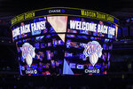 The scoreboard displays a message welcoming fans to an NBA basketball game between the Golden State Warriors and the New York Knicks on Tuesday, Feb. 23, 2021, in New York. (Wendell Cruz/Pool Photo via AP)
