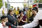 Student Marianna Torres, 11, center, cries as she evacuates Park Avenue Elementary School after jet fuel fell on the school in Cudahy, Calif., Tuesday, Jan. 14, 2020. Jet fuel dumped by an aircraft returning to Los Angeles International Airport fell onto the school playground where children were playing Tuesday, fire officials said. The Los Angeles County Fire Department said firefighters assessed over a dozen children and several adults who complained of minor injuries and none needed to be taken to a hospital. (AP Photo/Damian Dovarganes)