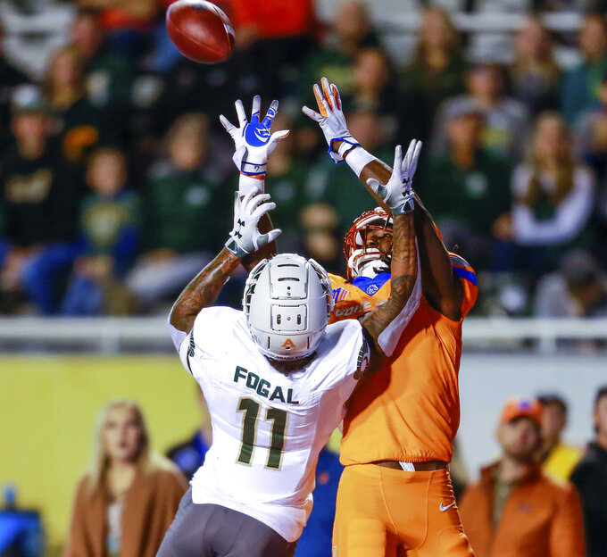 Boise State wide receiver A.J. Richardson (7) reaches for the ball while he battles with Colorado State safety Jordan Fogal (11) in the first half of an NCAA college football game, Friday, Oct. 19, 2018, in Boise, Idaho. Richardson pulled in the catch. (AP Photo/Steve Conner)