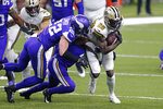 New Orleans Saints running back Latavius Murray (28) carries against Minnesota Vikings strong safety Harrison Smith (22) in the first half of an NFL football game in New Orleans, Friday, Dec. 25, 2020. (AP Photo/Brett Duke)