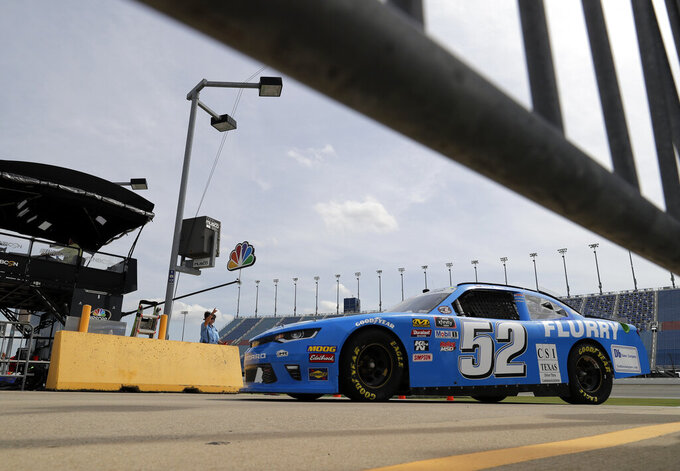 David Starr drives to his garage during a NASCAR Xfinity Series auto race practice at Chicagoland Speedway in Joliet, Ill., Friday, June 28, 2019. (AP Photo/Nam Y. Huh)
