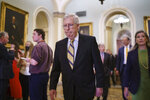 Senate Minority Leader Mitch McConnell, R-Ky., joined at right by Sen. Joni Ernst, R-Iowa, arrives to meet with reporters following a weekly strategy luncheon, at the Capitol in Washington, Tuesday, July 20, 2021. (AP Photo/J. Scott Applewhite)