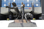 A statue of former Carolina Panthers owner Jerry Richardson stands outside an entrance to Bank of America Stadium in Charlotte, N.C., Tuesday, July 10, 2018. New owner David Tepper said during a news conference at the stadium Tuesday that he is contractually obligated to retain the statue. (AP Photo/Chuck Burton)