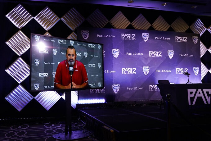 CORRECTS TO WASHINGTON STATE NOT WASHINGTON AS ORIGINALLY SENT - Washington State head coach Nick Rolovich answers question via video conference during the Pac-12 Conference NCAA college football Media Day Tuesday, July 27, 2021, in Los Angeles. (AP Photo/Marcio Jose Sanchez)
