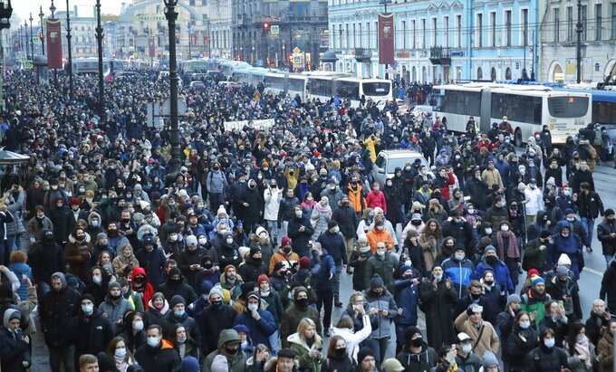 People march during a protest against the jailing of opposition leader Alexei Navalny in St.Petersburg, Russia, Saturday, Jan. 23, 2021. Russian police are arresting protesters demanding the release of top Russian opposition leader Alexei Navalny at demonstrations in the country's east and larger unsanctioned rallies are expected later Saturday in Moscow and other major cities. (AP Photo/Dmitri Lovetsky)