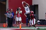 Cincinnati's Alec Pierce (12) makes a touchdown reception against Indiana's Tiawan Mullen (3) during the second half of an NCAA college football game, Saturday, Sept. 18, 2021, in Bloomington, Ind. Cincinnati won 38-24. (AP Photo/Darron Cummings)