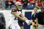 Tampa Bay Buccaneers wide receiver Mike Evans scores a touchdown against the Tennessee Titans in the first half of an NFL football game Sunday, Oct. 27, 2019, in Nashville, Tenn. (AP Photo/James Kenney)