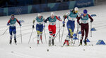Gold Medal winner Stina Nilsson, of Sweden, (1) leads the pack during the women's cross-country skiing sprint classic at the 2018 Winter Olympics in Pyeongchang, South Korea, Tuesday, Feb. 13, 2018. (AP Photo/Dmitri Lovetsky)