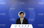 Bank of Korea Gov. Lee Ju-yeol speaks during a press conference in Seoul, South Korea, Thursday, July 12, 2018. South Korea's central bank has cut its forecast on the country's economy, citing mounting uncertainties from the U.S.-China trade battle. Bank of Korea said Thursday it lowered its growth outlook on Asia's fourth-largest economy to 2.9 percent this year, compared with its earlier forecast of 3 percent growth.(AP Photo/Lee Jin-man)