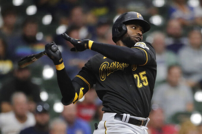 Pittsburgh Pirates' Gregory Polanco watches his RBI single during the 10th inning of the team's baseball game against the Milwaukee Brewers on Tuesday, Aug. 3, 2021, in Milwaukee. (AP Photo/Aaron Gash)