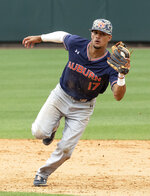 """FILE - In this June 8, 2019, file photo, Auburn's Will Holland (17) fields a ground ball against North Carolina during Game 1 at the NCAA college baseball super regional tournament, in Chapel Hill, N.C. The College World Series has an even stronger Southeastern Conference flavor than usual. """"We're just a gritty group of guys,"""" Auburn shortstop Will Holland said. """"We don't stop.''(AP Photo/Ben McKeown, File)"""