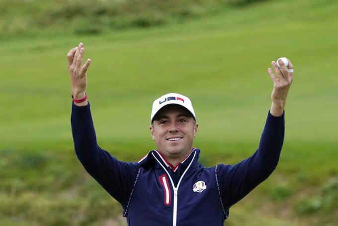 Team USA's Justin Thomas gestures to the crowd on the ninth hole during a practice day at the Ryder Cup at the Whistling Straits Golf Course Thursday, Sept. 23, 2021, in Sheboygan, Wis. (AP Photo/Ashley Landis)