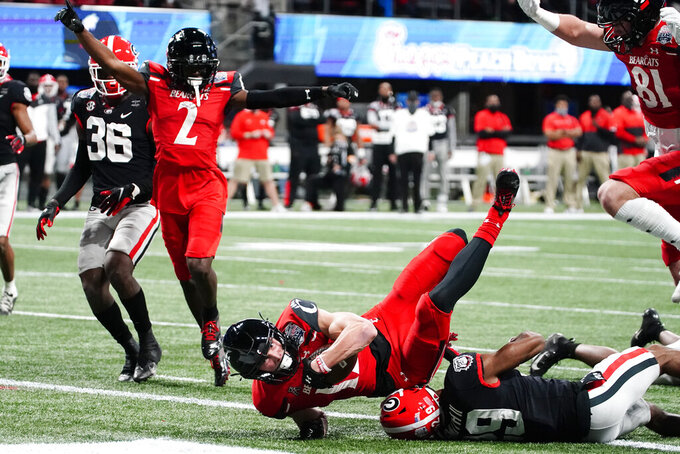 Cincinnati wide receiver Alec Pierce (12) scores a touchdown against Georgia during the first half of the Peach Bowl NCAA college football game, Friday, Jan. 1, 2021, in Atlanta. (AP Photo/Brynn Anderson)