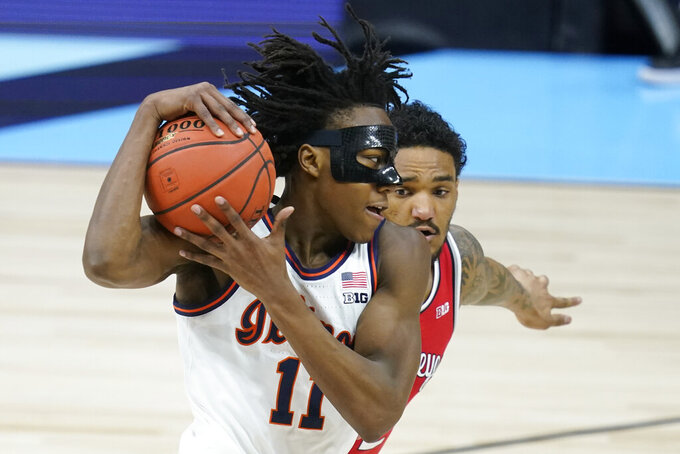 Illinois's Ayo Dosunmu (11) goes to the basket against Ohio State's Musa Jallow (2) during the first half of an NCAA college basketball championship game at the Big Ten Conference tournament, Sunday, March 14, 2021, in Indianapolis. (AP Photo/Darron Cummings)