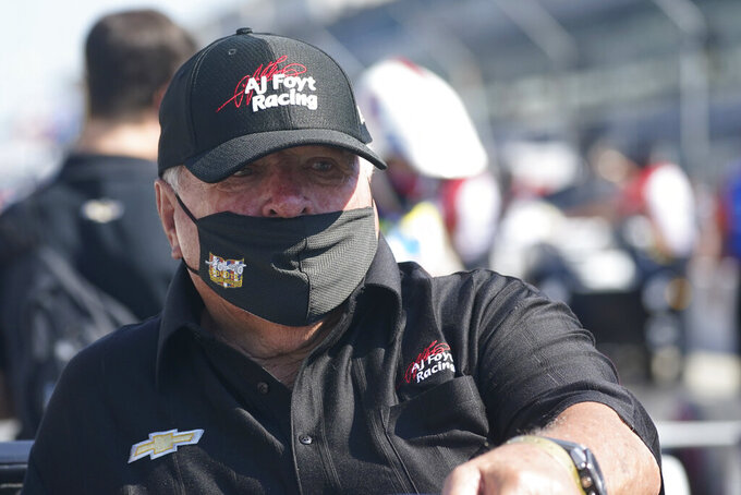 A.J. Foyt watches during qualifications for the Indianapolis 500 auto race at Indianapolis Motor Speedway, Saturday, Aug. 15, 2020, in Indianapolis. Even the seemingly indestructible 85-year-old, four-time Indianapolis 500 winner finds himself reluctantly wearing a mask and social distancing. (AP Photo/Darron Cummings)