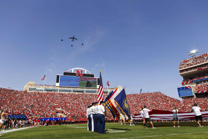 To commemorate the 20th anniversary of 9/11, the 155th Air Refueling Wing of Lincoln, Neb., flies a KC-135 Stratotanker, center, alongside three F-16 Fighting Falcons flown by the 114th Fighter Wing of Sioux Falls, South Dakota, over Memorial Stadium during the playing of the national anthem before Buffalo plays against Nebraska in an NCAA college football game, Saturday, Sept. 11, 2021, in Lincoln, Neb. (AP Photo/Rebecca S. Gratz)