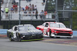 Ty Gibbs (54) passes Preston Pardus (90) through Turn 1 in the NASCAR Xfinity Series auto race at Watkins Glen International in Watkins Glen, N.Y., Saturday, Aug. 7, 2021. (AP Photo/Joshua Bessex)