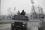 An Indian army soldier on top of his armored vehicle guards as a convoy of New Delhi-based diplomats passes through Srinagar, Indian controlled Kashmir, Thursday, Jan. 9, 2020. Envoys from 15 countries including the United States are visiting Indian-controlled Kashmir starting Thursday for two days, the first by New Delhi-based diplomats since India stripped the region of its semi-autonomous status and imposed a harsh crackdown in early August. (AP Photo/Mukhtar Khan)