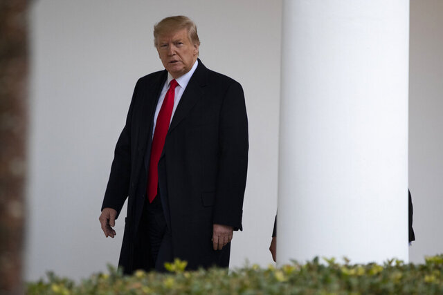 President Donald Trump walks to a meeting in the Oval Office with Guatemalan President Jimmy Morales, Tuesday, Dec. 17, 2019, in Washington. (AP Photo/ Evan Vucci)