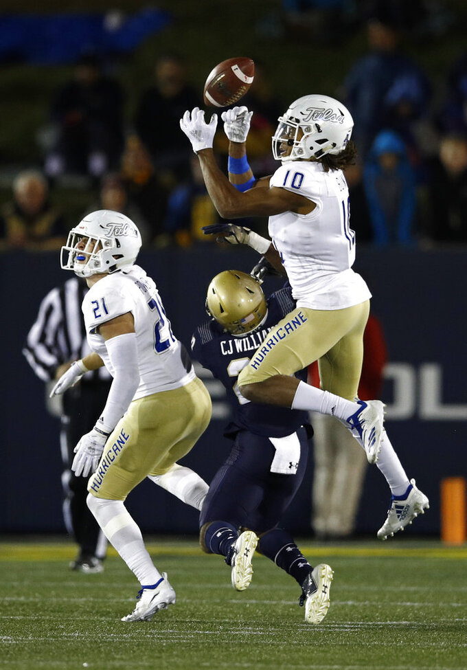 Tulsa safety Manny Bunch (10) breaks up a pass attempt to Navy tight end CJ Williams, center, in the second half of an NCAA college football game, Saturday, Nov. 17, 2018, in Annapolis, Md. Also pictured is Tulsa safety Bryson Powers (21). (AP Photo/Patrick Semansky)