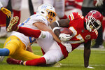 Kansas City Chiefs' Rashad Fenton is tackled by Los Angeles Chargers linebacker Cole Christiansen, left, during the first half of an NFL football game, Sunday, Jan. 3, 2021, in Kansas City. (AP Photo/Charlie Riedel)