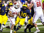 Wisconsin running back Jonathan Taylor (23) rushes, defended by Michigan linebacker Devin Bush (10), during the fourth quarter of an NCAA college football game in Ann Arbor, Mich., Saturday, Oct. 13, 2018. Michigan won 38-13. (AP Photo/Tony Ding)