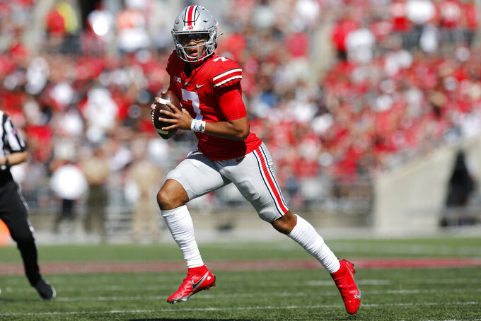Ohio State quarterback C.J. Stroud looks for an open receiver during the first half of an NCAA college football game against Maryland, Saturday, Oct. 9, 2021, in Columbus, Ohio. Ohio State beat Maryland 66-17. (AP Photo/Jay LaPrete)