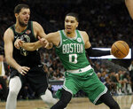 Boston Celtics' Jayson Tatum (0) drives to the basket against Milwaukee Bucks' Nikola Mirotic during the second half of an NBA basketball game Thursday, Feb. 21, 2019, in Milwaukee. (AP Photo/Aaron Gash)
