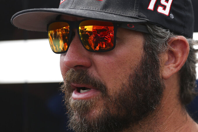 Martin Truex Jr. answers questions during a media availability session during a NASCAR Cup Series auto race in Watkins Glen, N.Y., Sunday, Aug. 8, 2021. (AP Photo/Joshua Bessex)