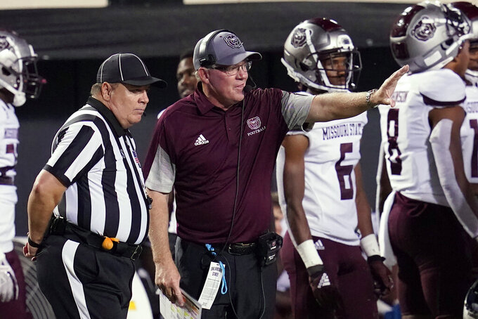 Missouri State coach Bobby Petrino talks with an official during the second half of the team's NCAA college football game against Oklahoma State, Saturday, Sept. 4, 2021, in Stillwater, Okla. (AP Photo/Sue Ogrocki)