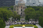 Visitors observe a minute of silence for the victims of the atomic bombing, at 8:15am, the time atomic bomb exploded over the city, at the Hiroshima Peace Memorial Park during the ceremony to mark the 75th anniversary of the bombing Thursday, Aug. 6, 2020, in Hiroshima, western Japan. (AP Photo/Eugene Hoshiko)