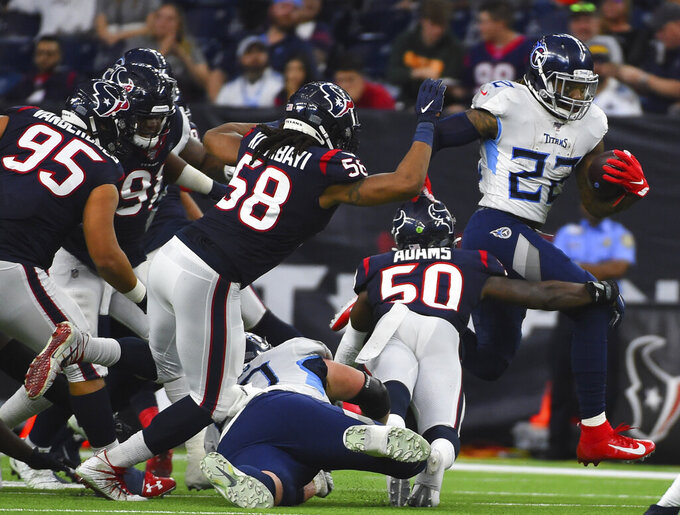 Tennessee Titans running back Derrick Henry (22) rushes for a gain as Houston Texans linebacker Tyrell Adams (50) reaches to tackle him during the second half of an NFL football game Sunday, Dec. 29, 2019, in Houston. (AP Photo/Eric Christian Smith)