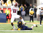 Stanford cornerback Paulson Adebo (11) intercepts a pass intended for California wide receiver Vic Wharton III in the fourth quarter of a football game in Berkeley, Calif., Saturday, Dec. 1, 2018. (AP Photo/John Hefti)