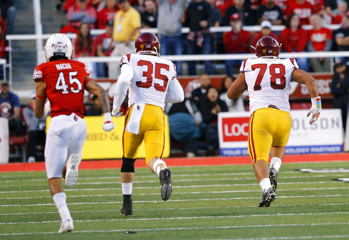 Southern California defensive lineman Jay Tufele (78) runs a fumble back for a touchdown against Utah in the first half during an NCAA college football game Saturday, Oct. 20, 2018, in Salt Lake City. (AP Photo/Rick Bowmer)