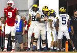 Michigan's Daylen Baldwin (85), Andrew Vastardis (68), Blake Corum (2) and Mike Sainristil (5) celebrate Corum's touchdown against Nebraska during the second half of an NCAA college football game Saturday, Oct. 9, 2021, at Memorial Stadium in Lincoln, Neb. (AP Photo/Rebecca S. Gratz)