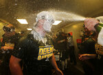 Oakland Athletics' J.B. Wendelken is doused in the clubhouse celebration after clinching a wild card spot after the baseball game against the Seattle Mariners, Monday, Sept. 24, 2018, in Seattle. (AP Photo/John Froschauer)