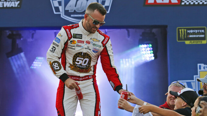 Austin Dillon greets fans during driver introductions for the NASCAR Monster Energy Cup series auto race at Richmond Raceway in Richmond, Va., Saturday, Sept. 21, 2019. (AP Photo/Steve Helber)