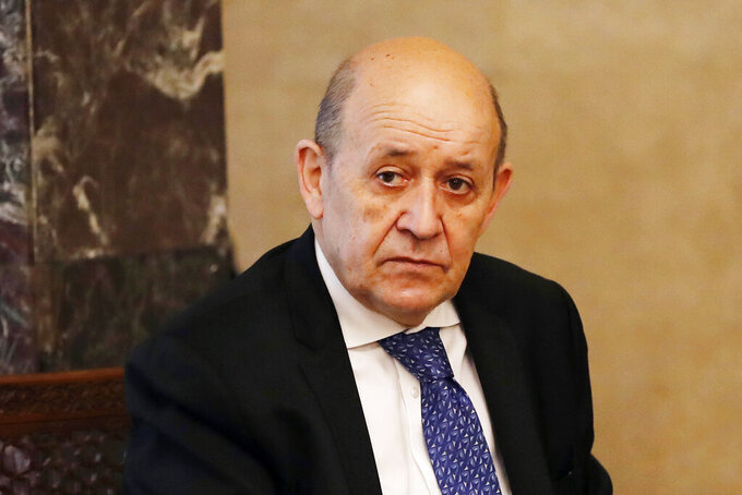 French Foreign Minister Jean-Yves Le Drian, looks on as he meets with Lebanese President Michel Aoun at the Presidential Palace in Baabda, east of Beirut, Lebanon, Thursday, May 6, 2021. Le Drian is in Beirut for two days visit to meet with Lebanese officials. (AP Photo/Hussein Malla)