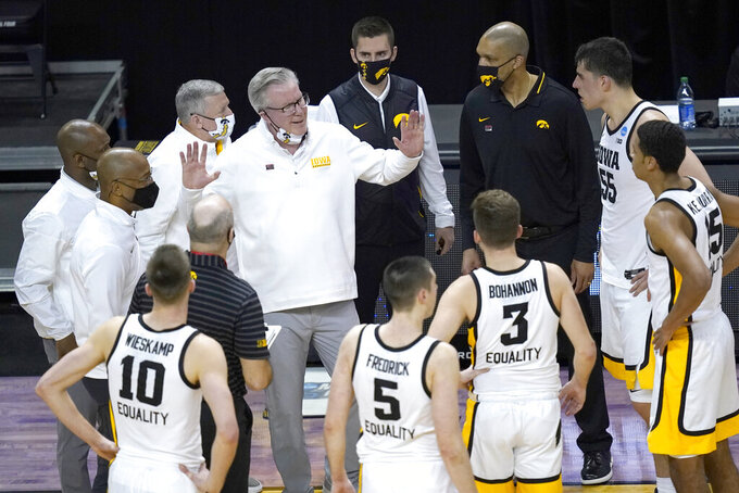 Iowa head coach Fran McCaffery, center, talks to his players during the second half of a first round NCAA college basketball tournament game against Grand Canyon Saturday, March 20, 2021, at the Indiana Farmers Coliseum in Indianapolis. Iowa won 86-74. (AP Photo/Charles Rex Arbogast)