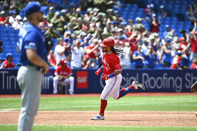 Toronto Blue Jays' Freddy Galvis rounds the bases after hitting a solo home run off Kansas City Royals' Glenn Sparkman during the third inning of a baseball game in Toronto on Monday, July 1, 2019. (Jon Blacker/The Canadian Press via AP)