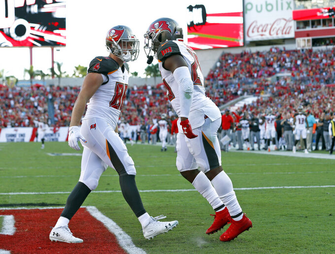Tampa Bay Buccaneers running back Peyton Barber, right, celebrates his touchdown against the Arizona Cardinals with tight end Tanner Hudson (88) during the second half of an NFL football game Sunday, Nov. 10, 2019, in Tampa, Fla. (AP Photo/Mark LoMoglio)