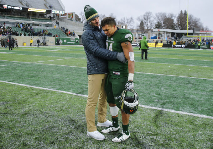Colorado State running back Izzy Matthews (24) is consoled after the team's 29-24 loss to Utah State during an NCAA football game Saturday, Nov. 17, 2018, in Fort Collins, Colo. (AP Photo/Jack Dempsey)