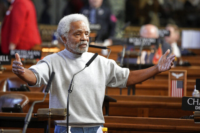 FILE- In this Jan. 8, 2020 file photo, Nebraska State Sen. Ernie Chambers of Omaha addresses lawmakers in Lincoln, Neb. On Wednesday, Feb. 12, 2020, lawmakers gave first-round approval to a bill sponsored by Sen. Chambers that would require law enforcement officers to undergo anti-bias training. The bill would require two hours of anti-bias and implicit bias training as part of the continuing education requirements for local police officers and sheriff's deputies. The Nebraska State Patrol would have to offer training as well to try to prevent racial profiling. (AP Photo/Nati Harnik, File)