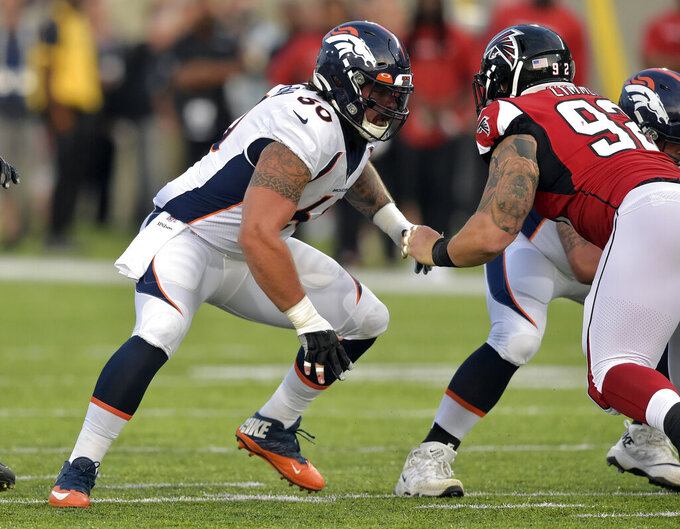 FILE - In this Aug. 1, 2019, file photo, Denver Broncos offensive guard Connor McGovern (60) blocks during the Pro Football Hall of Fame NFL preseason game against the Atlanta Falcons in Canton, Ohio. McGovern's tireless work ethic was born from football and potatoes. The big, Midwest-bred New York Jets offensive lineman spent his childhood playing on the ballfields of Fargo, North Dakota, and helping out on the potato-filled farms owned by his family. (AP Photo/David Richard, File)
