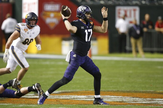 TCU quarterback Grayson Muehlstein (17) throws a pass as California linebacker Evan Weaver, left, watches during the first half of the Cheez-It Bowl NCAA college football game Wednesday, Dec. 26, 2018, in Phoenix. (AP Photo/Ross D. Franklin)