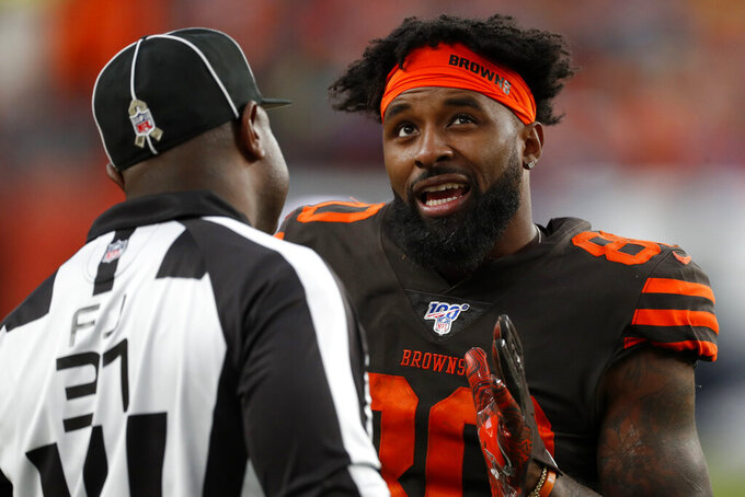 Cleveland Browns wide receiver Jarvis Landry (80) pleads with field judge Mearl Robinson during the second half of NFL football game against the Denver Broncos, Sunday, Nov. 3, 2019, in Denver. (AP Photo/David Zalubowski)