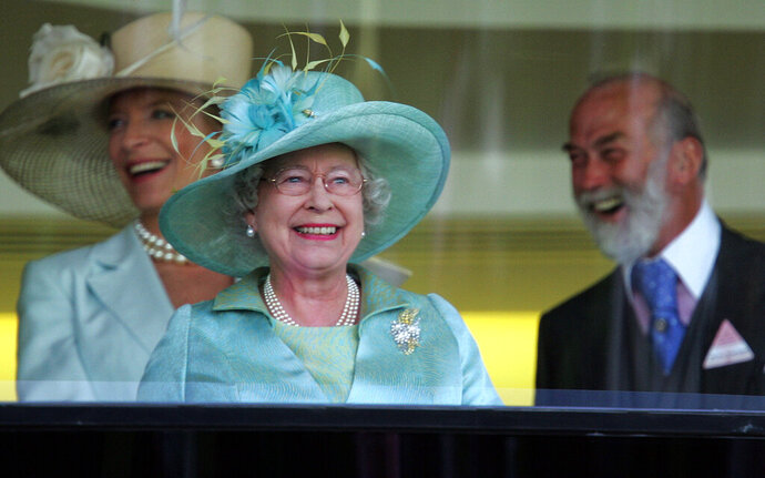 FILE - In this Wednesday, June 21, 2006 file photo, Britain' Queen Elizabeth II, centre, with Prince Michael of Kent, and Princess Michael of Kent celebrate after the horse Ouija Board won the Prince of Wales Stakes on the second day of the annual Royal Ascot horse race meeting, in Ascot, England. Queen Elizabeth II will not be attending the Royal Ascot horse racing meeting for the first time during her 68-year reign. The meeting, which commences Tuesday, June 16, 2020 is one of the country's most high-profile horse racing meetings and one that effectively launches a great British summer of sport that also includes Wimbledon tennis and golf's Open Championship.  (AP Photo/Alastair Grant)