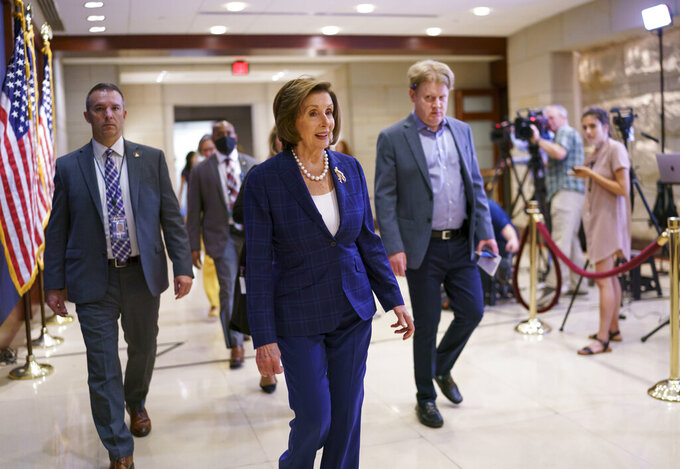 House Speaker Nancy Pelosi, D-Calif., arrives to meet with the House Democratic Caucus and Biden administration officials to discuss progress on an infrastructure bill, at the Capitol in Washington, Tuesday, June 15, 2021. (AP Photo/J. Scott Applewhite)