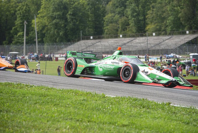 Colton Herta (88) holds the lead during an IndyCar Series auto race at Mid-Ohio Sports Car Course, Sunday, Sept. 13, 2020, in Lexington, Ohio. (AP Photo/Phil Long)